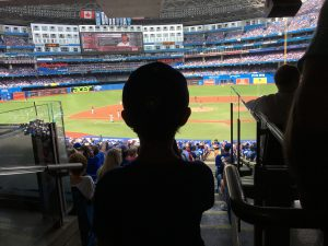 A child looking at the baseball diamond in awe