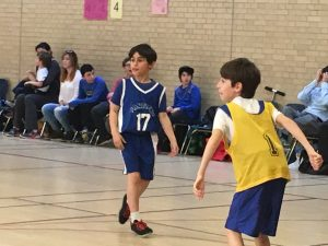Sporting the number 17 jersey playing basketball